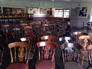 Pub chairs being cleaned